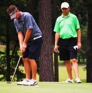 Jeremy McGatha (L) sinks a birdie putt on 18 to clinch the Dub Ellis Invitational at Cherokee County CC with Matt Rogers looking on. In the main photo, McGatha is congratulated by Bo Abney after the round. (Photos by Kurt Duryea)