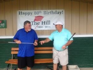 Longtime Anniston Municipal members (above L-R) Pat O'Brien and Tom Sawyer talk about old times before The Hill's 80th anniversary tournament. (Below L-R) Roger Jackson and Keith Robertson cut the birthday cake.