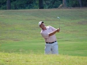 Gary Wigington hits an approach shot into a green late in his round Sunday en route to winning the Pine Hill CC Invitational.