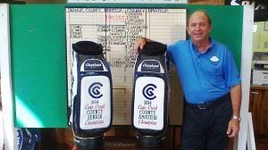 City director of golf operations Kenny Szuch stands with the embroidered staff bags that go to the winners of the Calhoun County Senior and County Championships. (Photo courtesy of Danny Waddell)