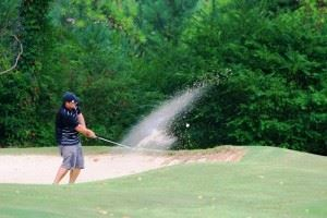 Nick Pollard blasts from a bunker during play on the back nine Sunday.