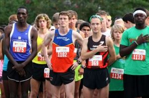 Eventual top three finishers Patrick Cheptoek (1075), Nathan Haskins (1102) and Josh Whitehead (969) pause for the National Anthem before leading the pack out on the Woodstock 5K. Enjoy all the images from Saturday's race. (Photos by Greg McWilliams) (Click to enlarge photos)