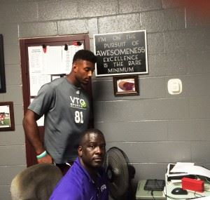 Justin Foster (L) will fill a lot of roles for Donoho coach Shannon Felder this season. Notice the message on the plaque above Foster's head.