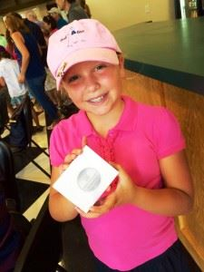 Isabel Rogers proudly displays the second-place medal she won for putting at the Drive, Chip and Putt competition Monday. In the main photo, Isabel and dad Matt commemorate the trip to the First Tee of Augusta. (Photos courtesy of Stacy McLean Rogers)