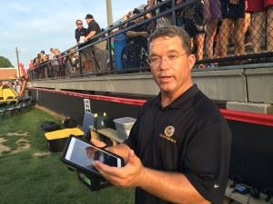 Wes Brooks, Oxford's director of football operations and baseball coach, explains the nuances of the Yellow Jackets' eye-in-the-sky game monitoring. In the main photo, he puts the technology to use.