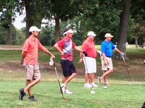The four players in the leaders group -- (from left) Eric Cannington, Jeremy McGatha, Benji Turley and Matt Rogers -- strike a similar pose as they look down the 14th fairway at Anniston Municipal Golf Course during the final round of the Buddy Moore Charity Classic Sunday. (Click photos to enlarge)