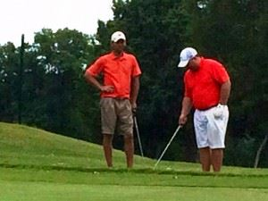 Eric Cannington (L) and Benji Turley look over their second shot into No. 12 Sunday. They birdied the hole and won a scorecard playoff for second place.