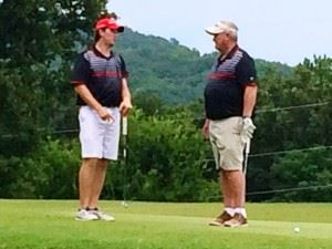 Andrew Brooks (L) and Steve Akers plot strategy on the 12th green Sunday.
