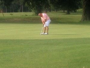 Grant Hockman drops his winning putt in the Fort McClellan Credit Union Pro-Invitational earlier this summer. He can win County Player of the Year by winning the County Championship this week.