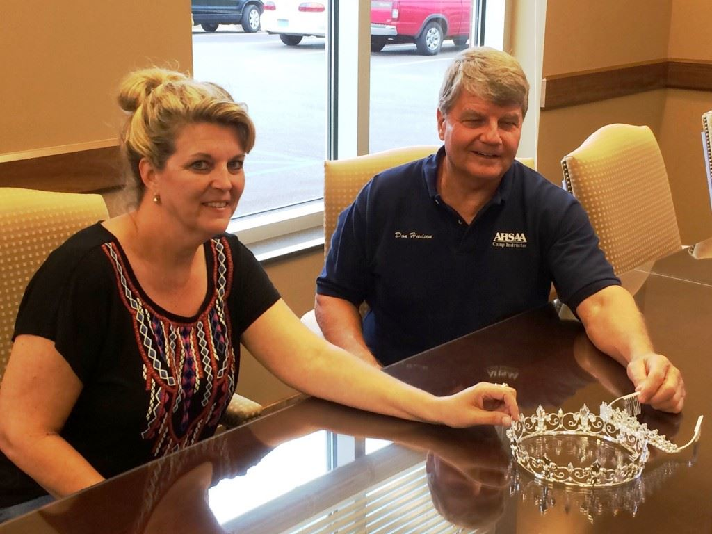 Director Don Hudson (R) and Pam Harris of the Oxford PARD sit with the crowns that will go to the king and queen of the Masters Games of Alabama Oct. 6-9.