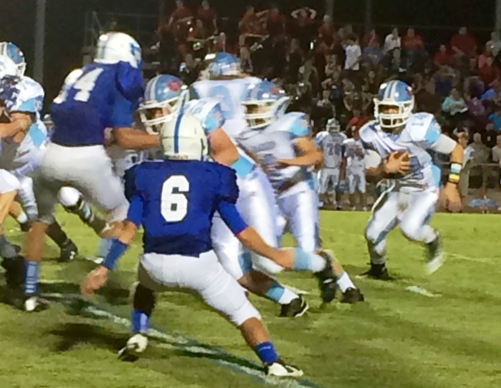 Pleasant Valley's Drew Lewiski (14) looks for running room against White Plains.