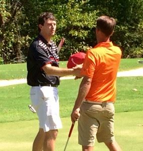 Andrew Brooks (L) gets a handshake from Jeremy McGatha after winning their County Match Play semifinal match Sunday.