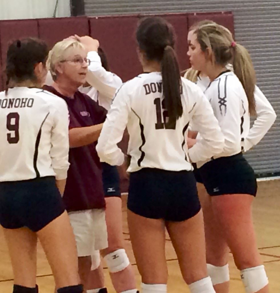 Donoho volleyball coach Janice Slay gives her team instructions during a time out in a recent win over Sacred Heart.