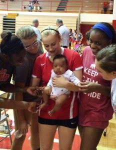 The Saks volleyball team is drawn to Wildcats senior libero Tiffany Springer and her daughter Tiana Rae.