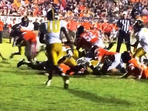 Alton Davis (far left) scores Alexandria's first touchdown on a fourth-and-goal from the 1.