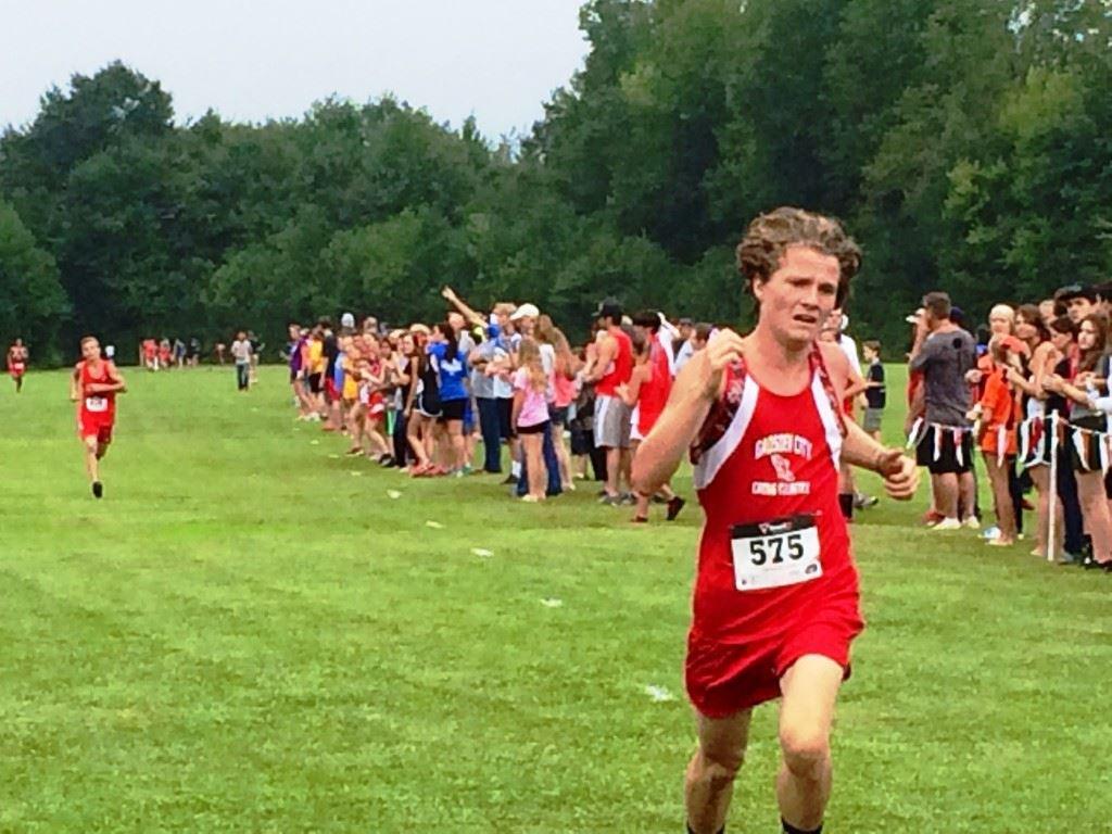 Steele Beavers of Gadsden City leads Ohatchee's Jimmy Wilson (background) across the line in the boys race.