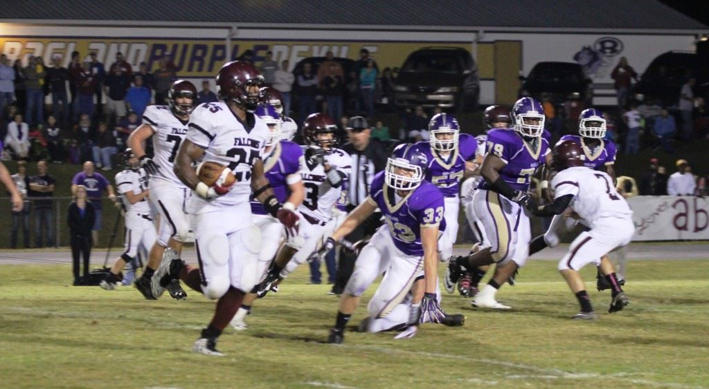 Donoho's Justin Foster (25) looks to turn the corner against Ragland. Foster scored four touchdowns in the Falcons' 27-8 victory. (Photos by Paige Faulkner)