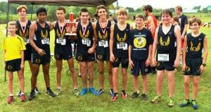 The Oxford boys cross-country team gets together after joining the girls team (cover) in sweeping the Creekbank Invitational at Oxford Lake Park. (All photos by Kurt Duryea)