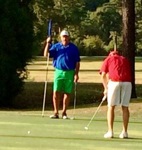 Andrew Brooks (R) sends his winning eagle putt toward the 18th hole in Thursday's championship match. In the main photo, Brooks points to his line on the bracket after winning the title.