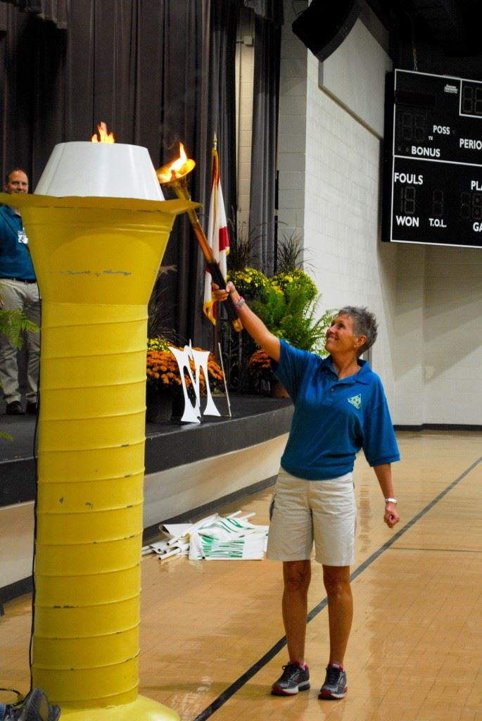 Belva Durham lights the Flame of Hope officially starting the Masters Games of Alabama in Oxford. In the cover photo (from left) Oxford Mayor Leon Smith, Oxford PARD director Don Hudson and Randy Frost of the East Alabama Planning Commission salute the nearly 600 athletes in the Games.