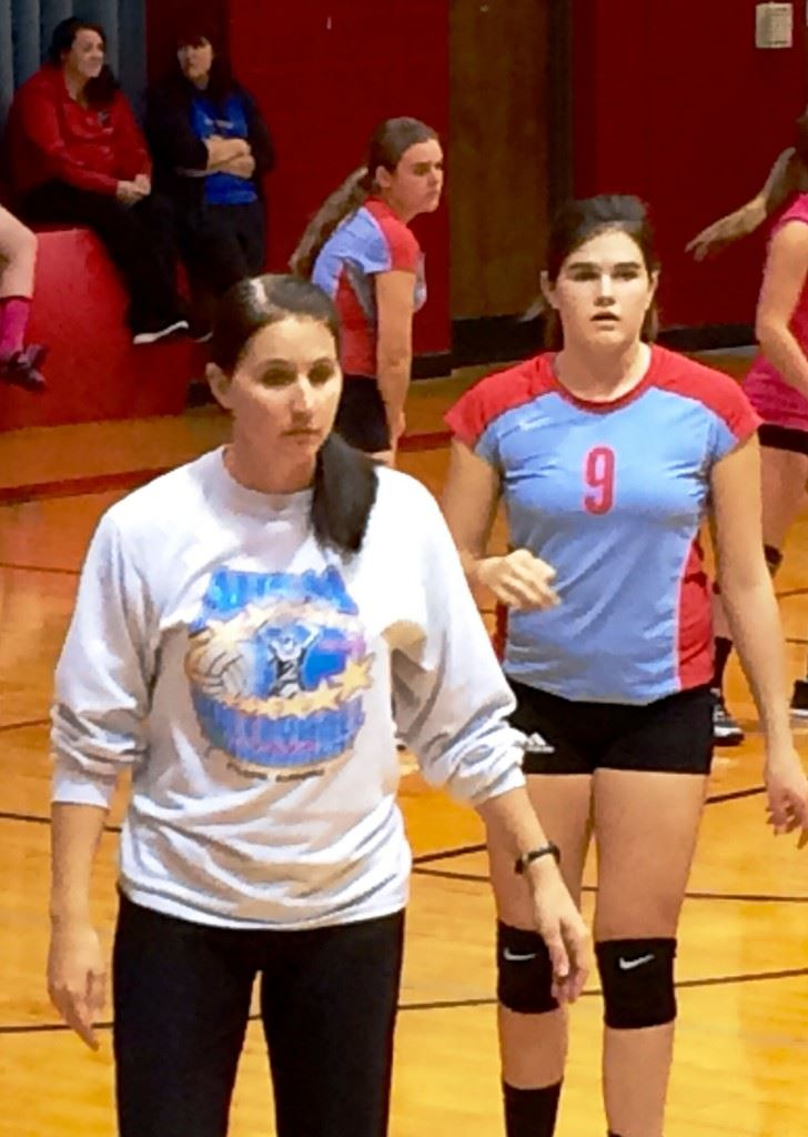 Pleasant Valley volleyball coach Dana Bryant hoped to give her team a sense of what they were playing for wearing a 2008 state tournament shirt during their area tournament Monday.