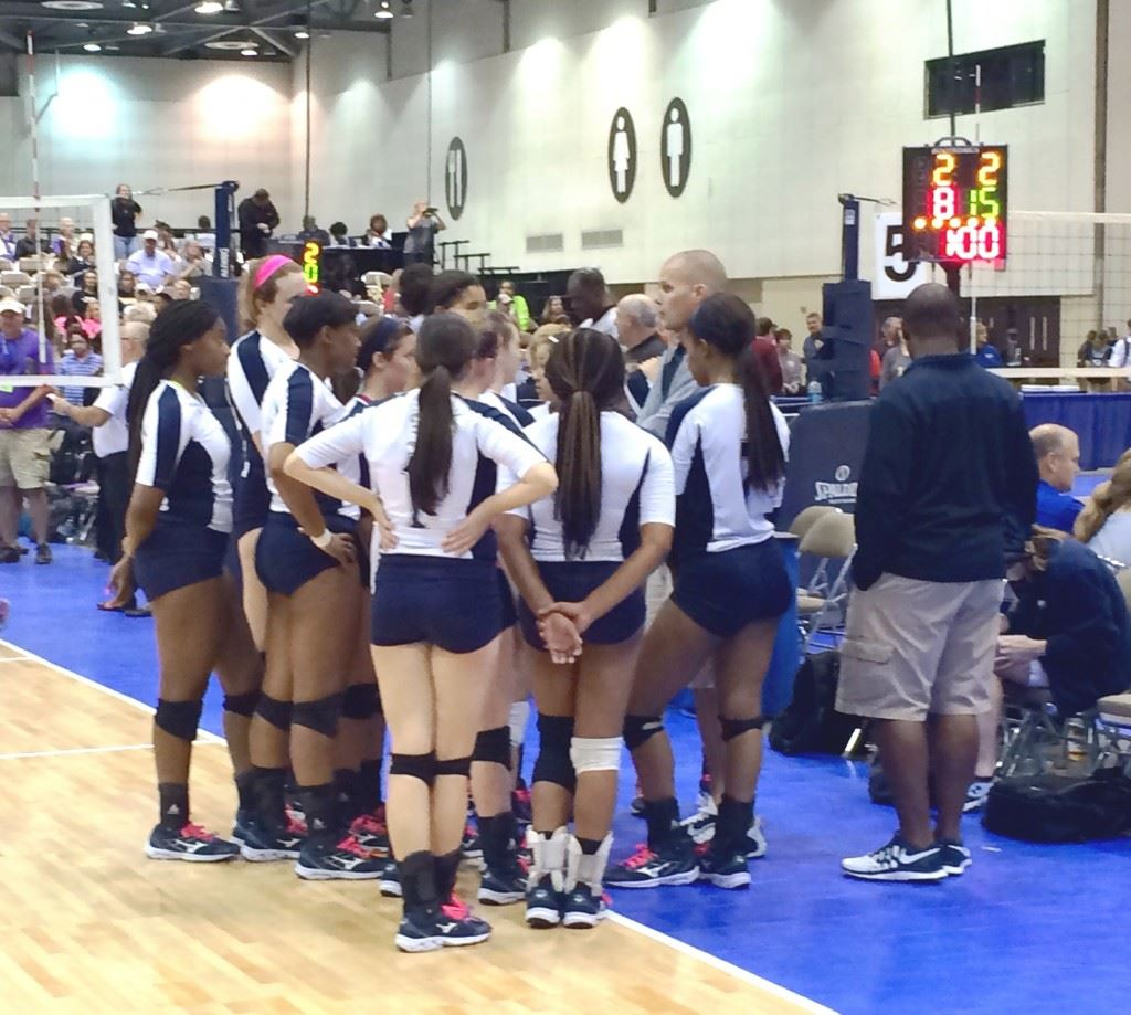 Jacksonville's volleyball team huddles after losing to Danville in the 4A North Super Regional final.
