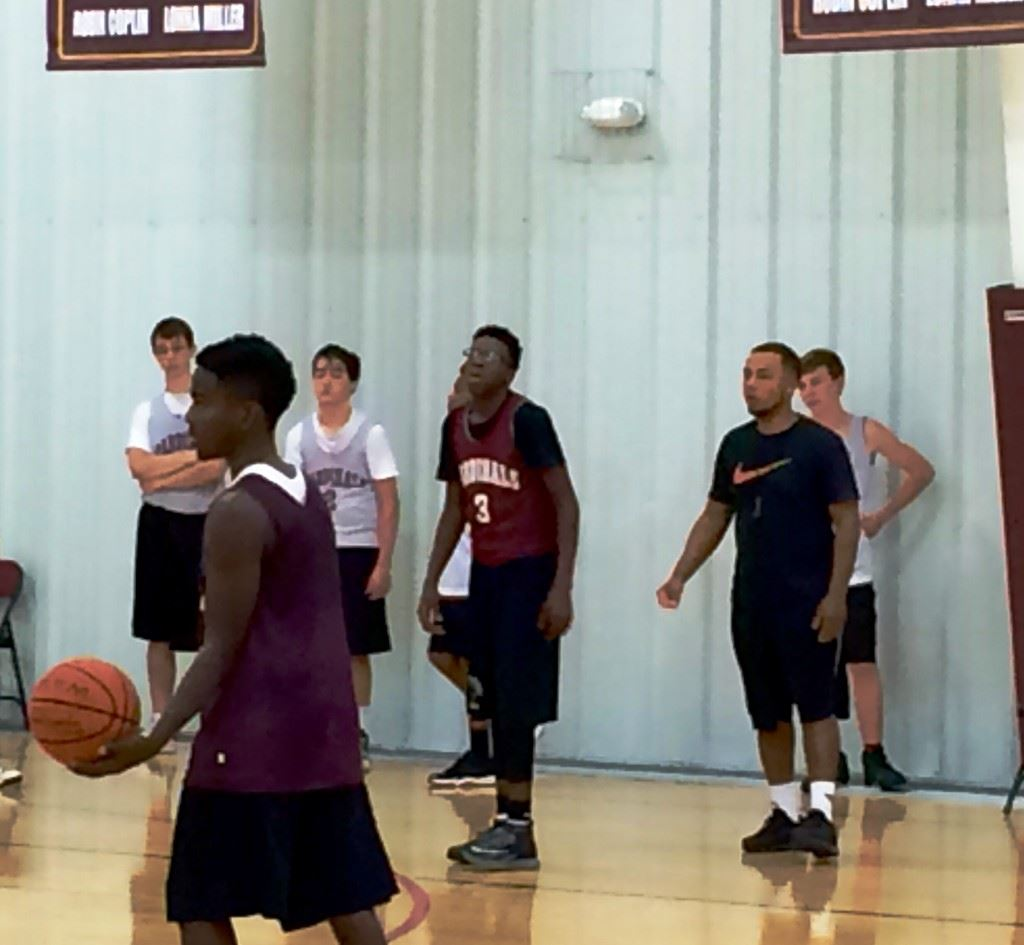 Sacred Heart coach Ralph Graves (R) puts his basketball team through practice Sunday.
