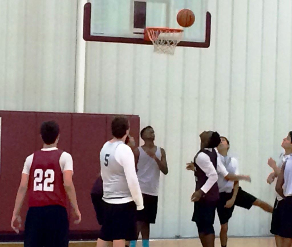 Sacred Heart players anxiously await the ball to drop for two or fall off the rim.