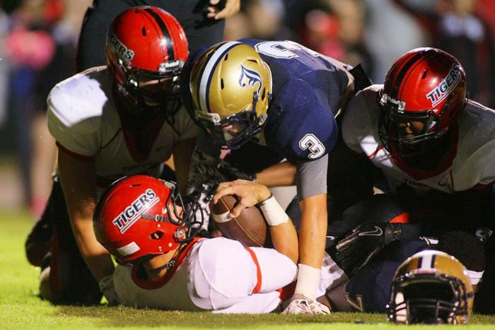 Cleburne County quarterback Brady Padgett is at the bottom of the pile, but not before scoring the go-ahead touchdown in the Tigers' 24-14 win over Jacksonville. (Photo by Greg McWilliams)