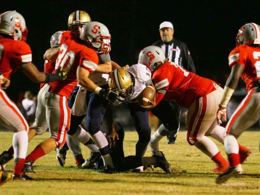 Jacksonville's Niko Richmond (13) gets bottled up by the Saks defense.
