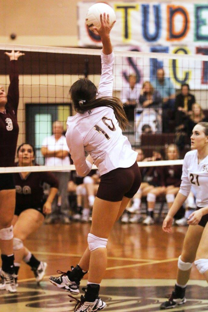 Kristen Rothwell sends a shot back across the net in Sacred Heart's five-set win over Donoho. (Photo courtesy of Kristen Stringer/Krisp Pics Photography)