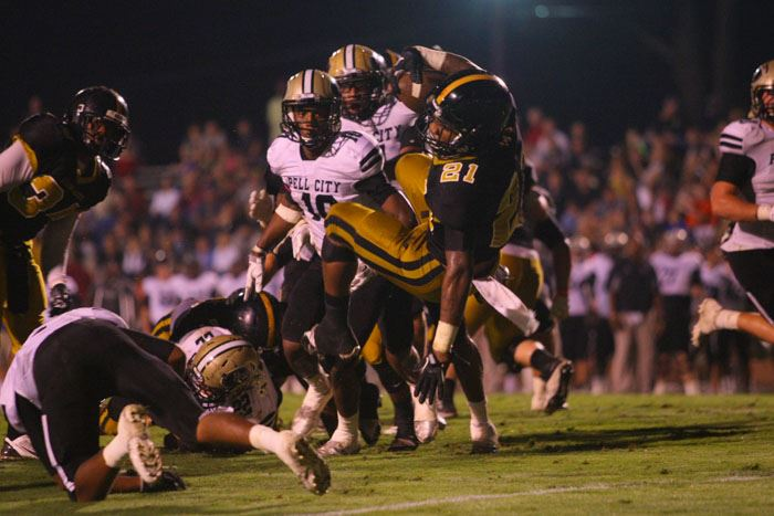Oxford's Tre Gamble (21) goes airborne to score one of his three touchdowns Friday night against Pell City.