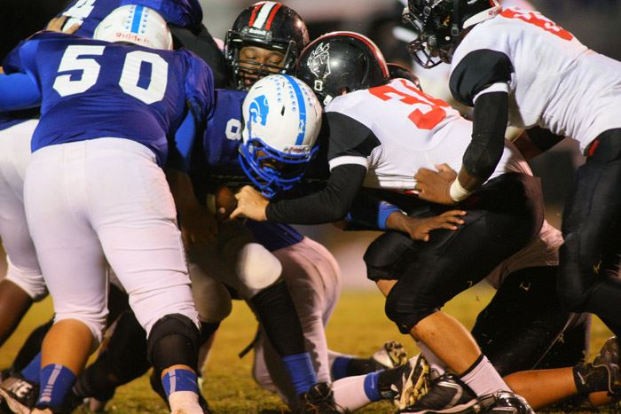 Kyle Clapper (34), wrapping up White Plains' Lawrence Jackson, played a big role in the Bearcats' shutout. (Photo by Greg McWilliams)