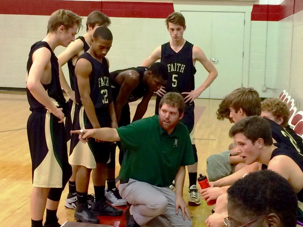 Faith Christian coach Bradley Dawson appeals to his team's tough side during a time out Thursday night.