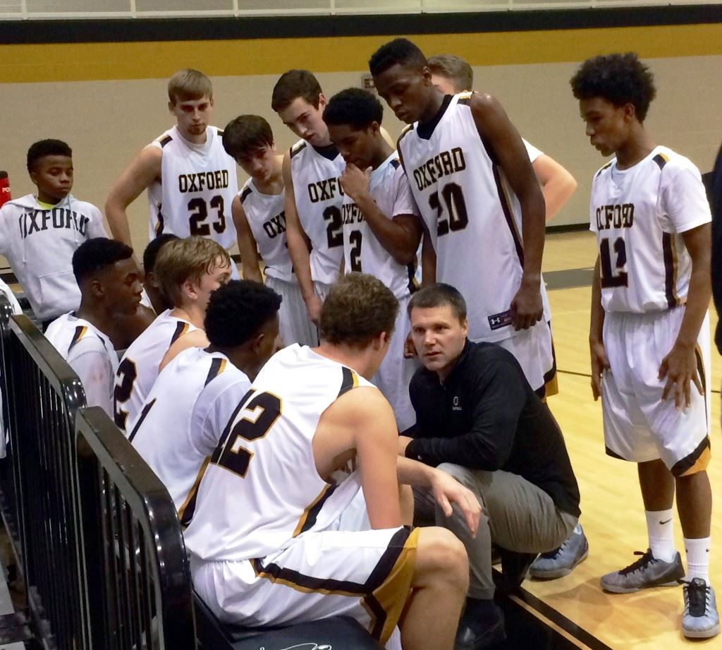 Oxford coach Joel Van Meter gives his team instructions during the final timeout with 41.5 seconds to play Saturday. The Yellow Jackets kept White Plains from scoring the rest of the game and secured a 63-56 victory.