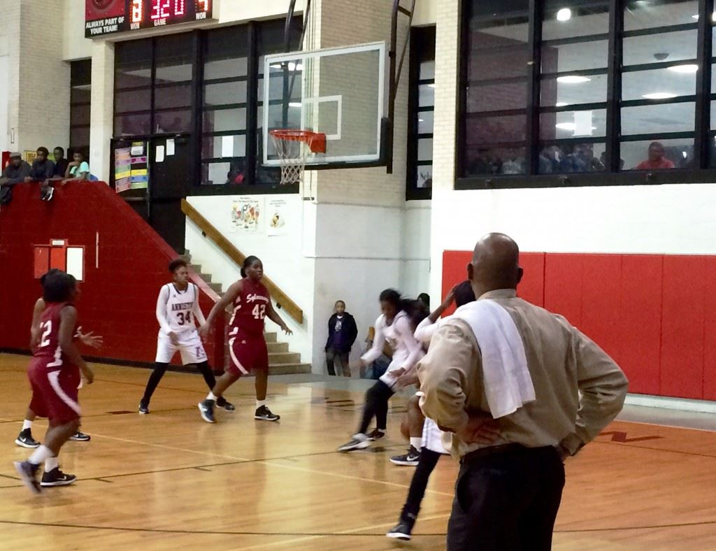 Anniston girls coach Eddie Bullock watches the early action unfold in Tuesday night's game with Sylacauga.