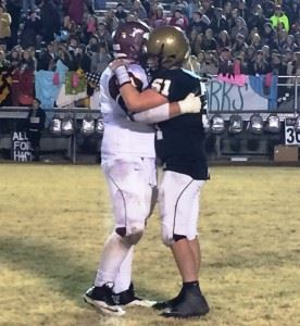 Madison Academy lineman William Dye respectfully embraces Glencoe's Ty Minshew (51) after Friday night's hard-fought 3A state semifinal game.