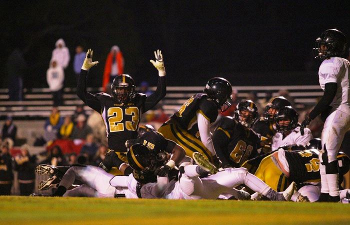 Oxford's Kenny Britt (23) signals touchdown as the pile unravels near the goal line Friday night. On the cover, Tre Gamble (left) prepares to take a hand off from quarterback Ty Webber. (Photos by Greg McWilliams)
