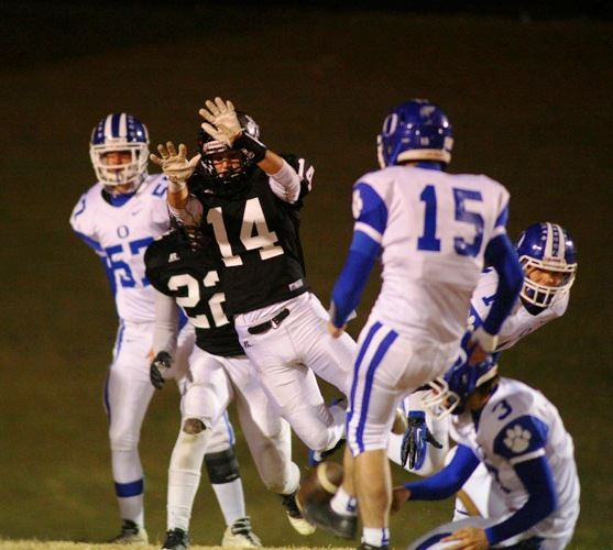 Jake Thrasher (14) breaks through to block an extra point late in the game that allowed Dakota King's field goal to win it for Wellborn. (Photo by Greg McWilliams)