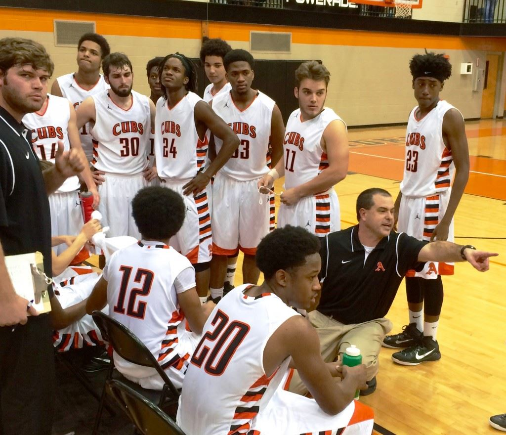 Alexandria basketball coach Jason Johnson tries to get somebody's attention during a timeout late in Tuesday night's game with Anniston.