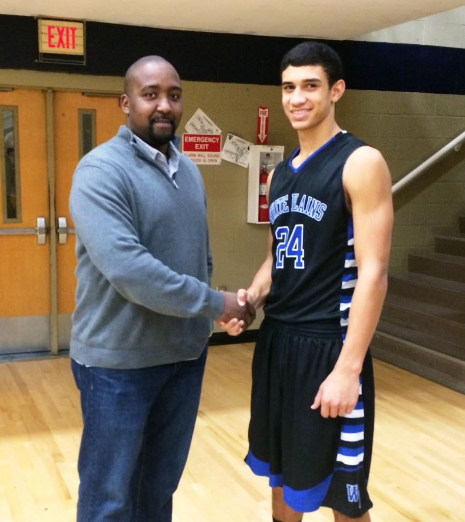 Jonathan Gilbert (left) is the only White Plains player to sign a Division I basketball scholarship, but his son Nathan could soon add to the family legacy. Below, Nathan (24) prepares to make his move in a recent game against Jacksonville. Nathan averages 19 points and nearly 10 rebounds a game this season.