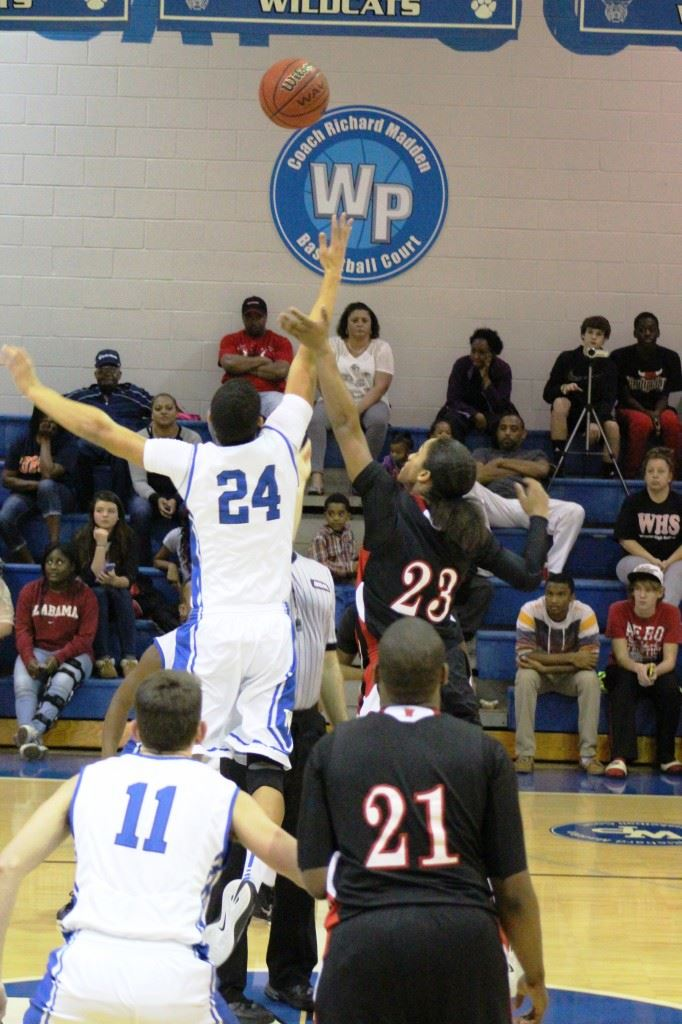 White Plains' Nathan Gilbert (24) wins the center jump and continued to be dominant all game Friday. (Photo by Micaela Truett)