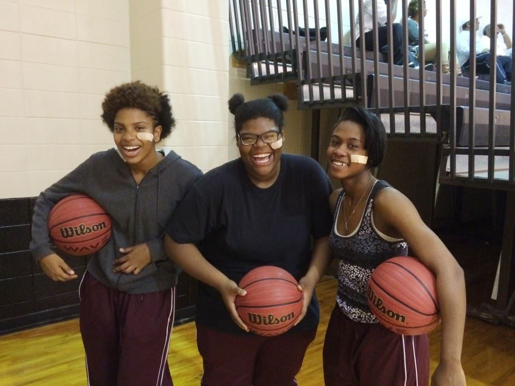 Ki-Yana Bullock (L), Jemya Bullock (C) and Raven Cooley display their team unity with band-aids under the left eye. It was an idea Jemya and Cooley floated earlier this year and it quickly spread through the team.