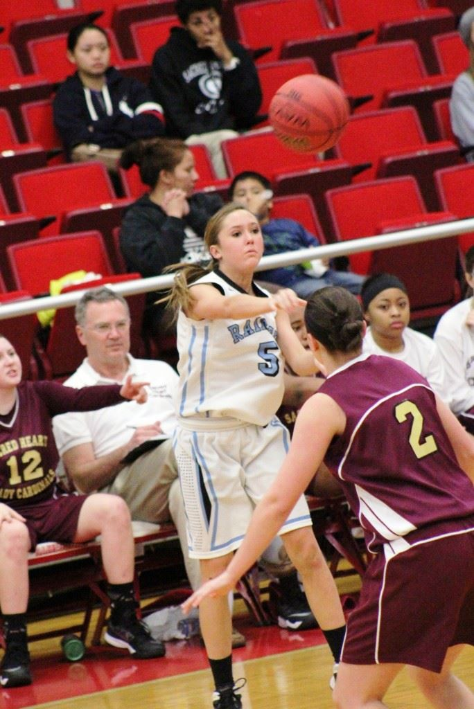Pleasant Valley's Atleigh Brannon (5) puts the ball in play against Sacred Heart. On the front, backcourt mate Tiffany Williams brings the ball up the floor. (Special photos)