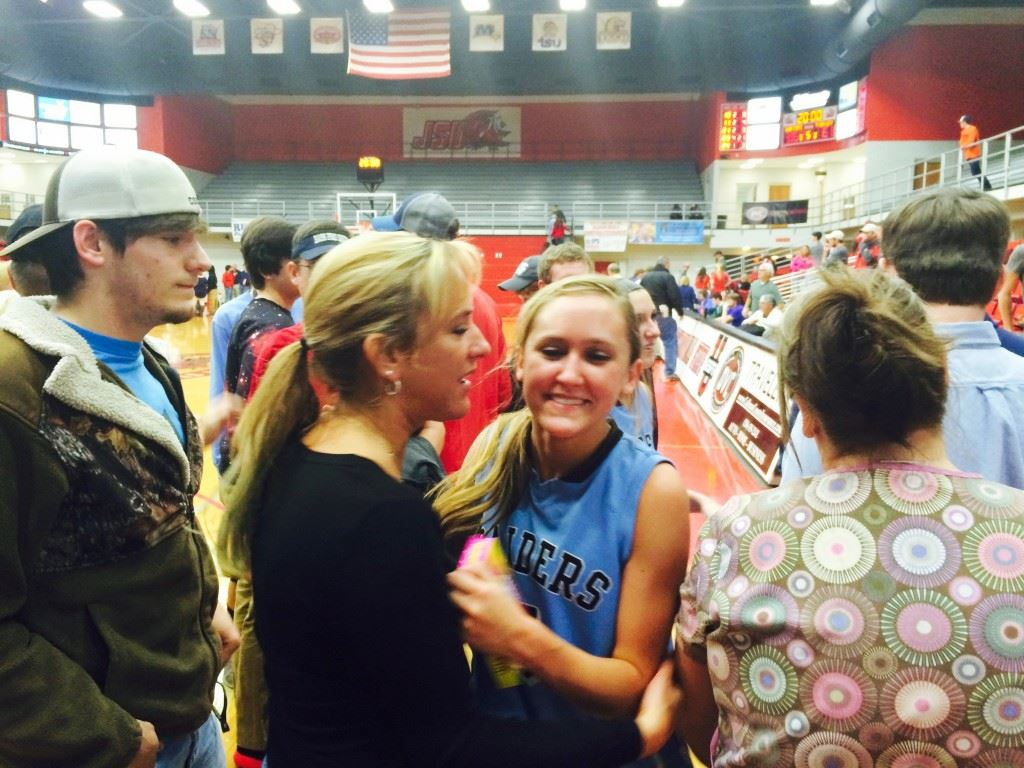 Pleasant Valley sophomore Atleigh Brannon gets a hero's reception after her big plays in overtime helped the Raiders upset Ohatchee.
