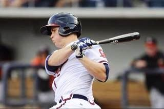 Todd Cunningham delivers a hit while playing for the Triple-A Gwinnett Braves. (Special photos)