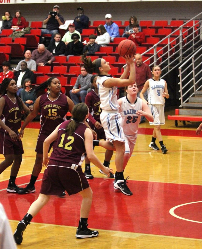Tiffany Williams flies down the lane for a layup against Sacred Heart. (Photo by Krista Walker)