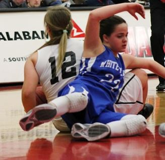 White Plains' Shelby Wood (22) gets tangled up with Wellborn's Carlee Mullinax. (Photo by Bridget Merriman)