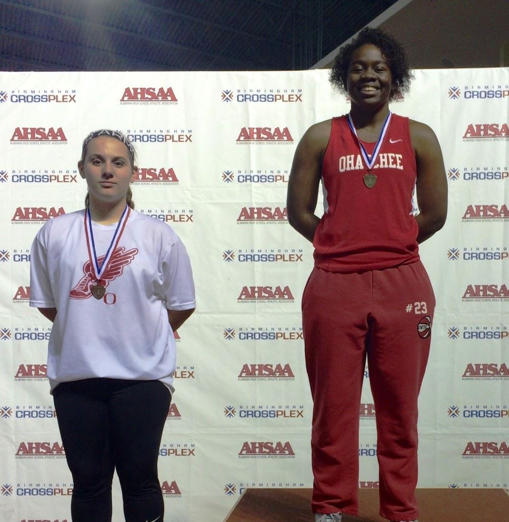 Ohatchee teammates Joria Steger (R) and Madeline Crider finished 1-3, respectively, in the girls 1A-3A shot put Friday at the state indoor track and field championships.