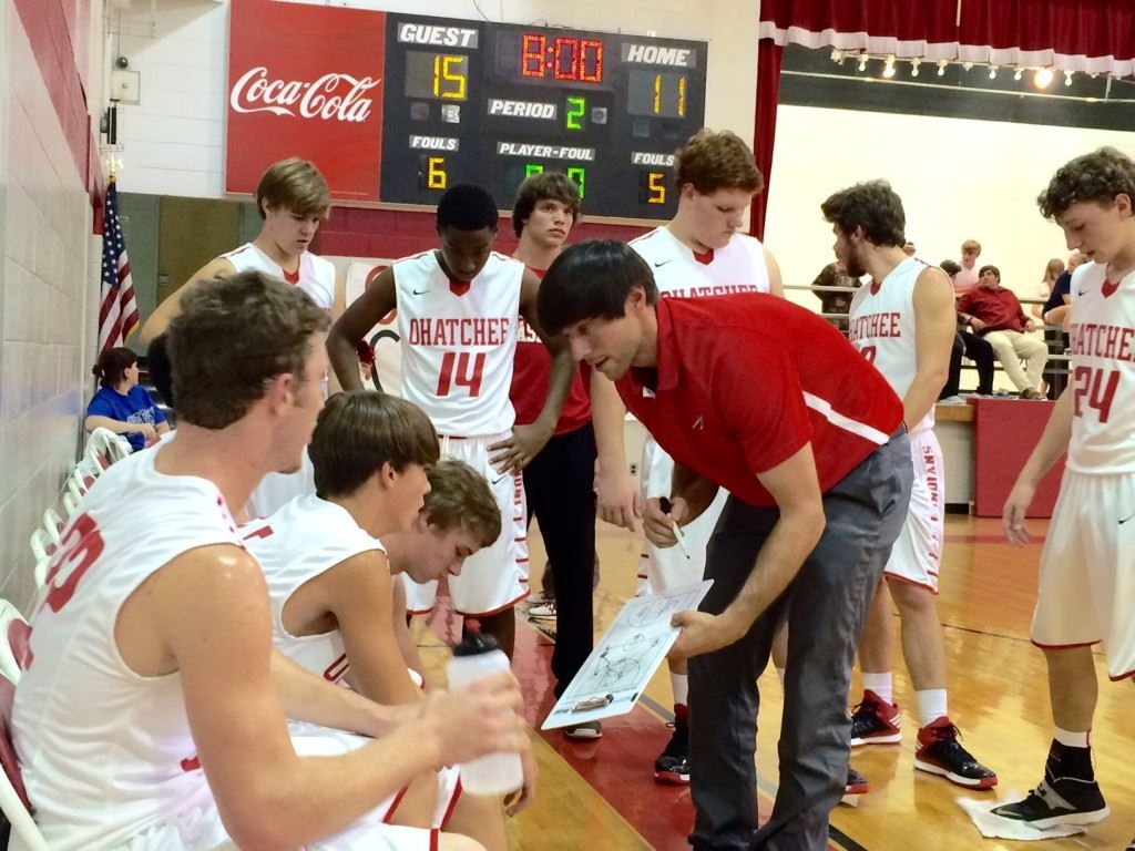 Freshman guard Ben Glass (second from left) listens intently to Ohatchee coach Bryant Ginn's instructions during a game earlier this season.